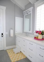 light grey wall color with nice small yellow bath rug using white vanity design for incredible bathroom ideas