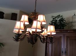 nine palm trees decorate this two tier chandelier bulbs included call 239 947 8840