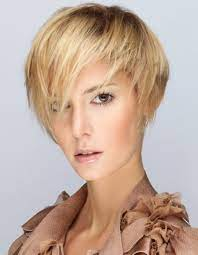 A regular boy cut with deep side parting and long cut till ears. Styles For Short Straight Hair