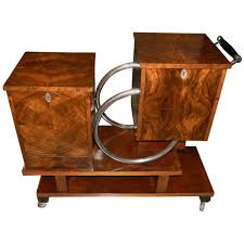 art moderne furniture. Art Deco Chrome And Wood Rolling Liquor Cabinet - Image Courtesy: Artdecocollection.com Moderne Furniture E