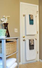 bathroom idea towel rods on back of door to hide the holes in my old bathroom wallpaper details