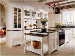 kitchen cabinets with granite countertops: antique white kitchen cabinets with black granite countertops