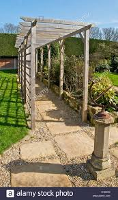 A pergola is a wooden walkway frame used in landscaping a garden