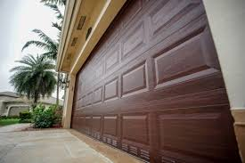 Residential garage door Raynor Hurricane Garage Doors Garage Doors Doors Garage Door Openers Residential Garage Doors Commercial Garage Doors Dade Safeway Door Worlds Strongest Garage Doors Residential Doors