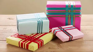 How to Wrap a Present With a Woven Ribbon Gift Topper