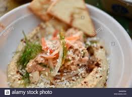 Seafood dip with hummus served with a ...