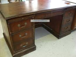 distressed solid wood desk with 6 drawers with brass pulls