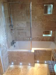 Bath Panel Lights We Love The Brown Granite Tiling Alongside The Bath Panel