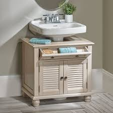 utilize that space around your pedestal sink with this stylish cabinet it provides ample bathroom