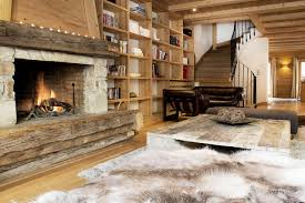 fireplace and fur rug in front chalet sarire val d isere alpine guru