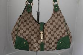 gucci brown fabric and deep green leather trim printed monogram gg shoudler bag