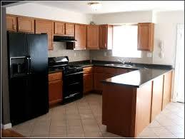 Small Kitchen Renovation Kitchen Cabinets White Cabinets Dark Grey Island Small Kitchen