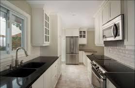 perfect white kitchen backsplash design idea for your kitchen modern galley kitchen black countertop white