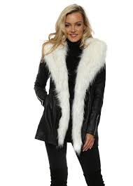 leather look coat with detachable white faux fur trim