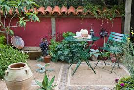 Image Deck Mediterranean Style Garden Courtyard Patio With Terracotta Roof Tile Fence Urns Garden Furniture Gardenphotoscom Photoshelter Outdoor Room Furniture Walls Plant Flower Stock Photography