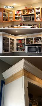 add crown molding and trim to the top of cabinets to increase kitchen appeal