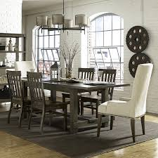seven piece dining set with rectangular table and upholstered host inspiring magnussen dining room
