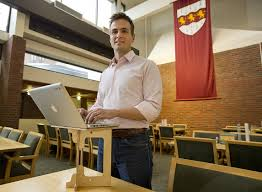 luke leafgren works on his portable standing desk invention in harvard s mather house dining hall on
