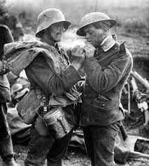 German and British soldiers share cigarettes during the 1914 Christmas  Truce. | World war i, World war one, World war