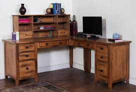 captivating corner space of classic office which has l shaped home office desks filled with open cabinets and several small drawers also has black monitor captivating home office desktop