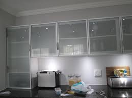 This kitchen is incorporating Aluminium frame cabinet doors with frosted  glass inserts. Aluminium frame doors