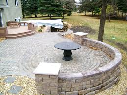 raised paver patio with seating safety wall by oasis landscapes in west fargo