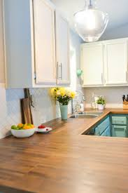 we totally transformed our dated 1980 s kitchen with bright painted cabinets new lighting and i thought getting butcher block