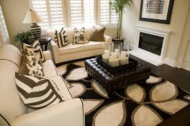 large ottoman coffee table. High Contrast Themed Living Room Features White Sofas With Black Trim, Patterned Rug Over Dark Large Ottoman Coffee Table E