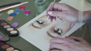 the make up artist trains on the face chart make up for the eyebrows make up artist draws eyebrows using a thin brush and eyebrow shadows stock video