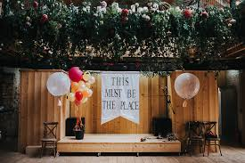 this must be the place se sign with giant balloons wedding decor