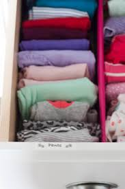 baby clothes folded and organized in a dresser drawer