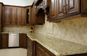 these cabinets are j k s chocolate maple cabinets the multi colored countertops and backsplash are a great match to compliment these gorgeous cabinets