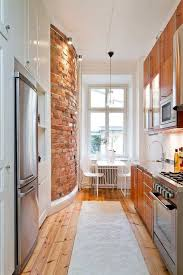 The layout of a narrow kitchen is usually found in small interiors. In big  urban cities, apartments often have long and narrow kitchens.