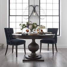 60 round flame gany dining room table sits 6