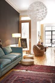 modern setting with a complementary colored sofa again i love the robin s egg with the darker red rugs especially