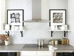 grey and white tile backsplash white herringbone subway tile teams with grey white beveled subway tile