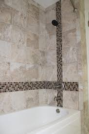 installing glass tiles in the bathroom shower using tile as an