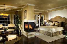 Traditional Master Bedroom with metal fireplace, Chandelier, Woodland  direct: pearl designer peninsula direct