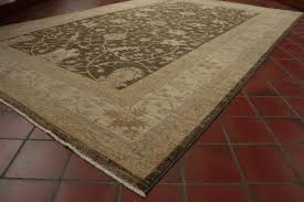 cream and gold rug hand made afghan carpet in soft colours of green gold and cream