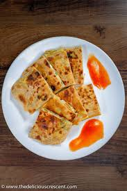 protein and good fiber egg paratha anda paratha is omelette stuffed in a layered flat bread it