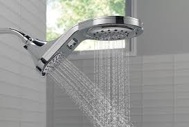 dual shower head operating water in a tile shower
