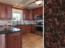 cherry cabinets and dark granite tan brown countertop