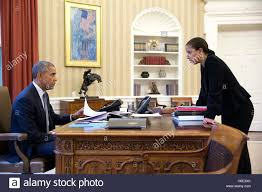 white house oval office desk. U.S. President Barack Obama Meets With National Security Advisor Susan Rice In The White House Oval Office Desk