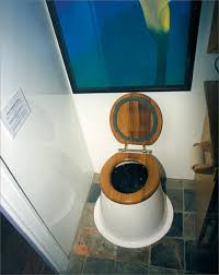 an indoor waterless toilet is shown instructions on use of the toilet can be seen