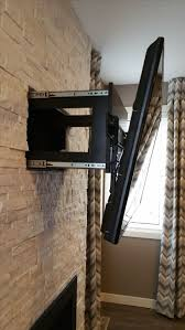 this is a fireplace with built in drawer behind tv mount to hide cables a