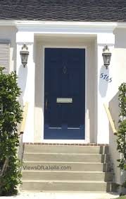 navy cobalt blue door white house add window bo with red yellow