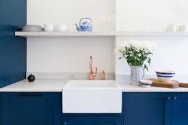 blue kitchen cabinets copper faucet