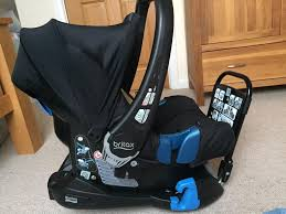 britax baby carrier with belted car seat base and rain cover in