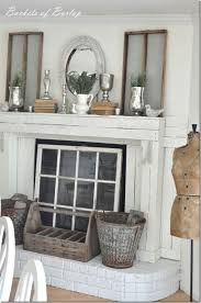 use vintage window in front of fireplace when spring comes and it s no longer in use