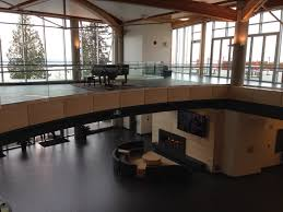 as you walk through the halls there are small rooms with a round table and 4 6 chairs where students can gather there are huge bean bag couches and work